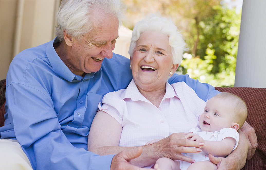 Happy grandparents with baby